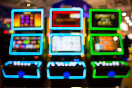 Out of focus blurry image of casino equipment. Blurred slot machines in a casino.