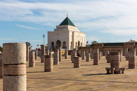Rabat, Morocco - 29 November 2018: The Mausoleum of Mohammed V which is a mausoleum located on the opposite side of the Hassan Tower, on the Yacoub al-Mansour esplanade in Rabat, Morocco.