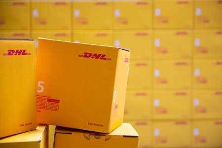Sofia, Bulgaria - 17 October, 2018: Yellow DHL Express packages are seen arranged in a warehouse. Imagens