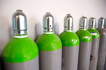 Seamless Steel Industrial Gas Cylinders. Pressurized Cylinder. Industrial stainless steel bottles in line. 스톡 콘텐츠 - 120442004