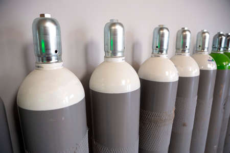 Seamless Steel Industrial Gas Cylinders. Pressurized Cylinder. Industrial stainless steel bottles in line. Imagens