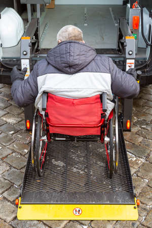 Minibus for handicapped, physically challenged and disabled people in wheelchairs. Minibus with stowed wheelchair ramp. Banco de Imagens