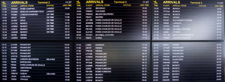 Boarding time monitor screens - timetable boards. Arrivals and departures monitors to check the status of a flight on the airport. Stock fotó