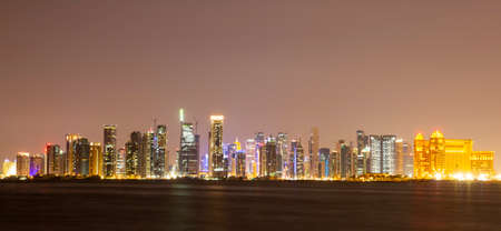The skyline panorama of the West Bay area of Doha, Qatar at night from another site. The West Bay is considered as one of the most prominent districts of Doha. Long exposure.