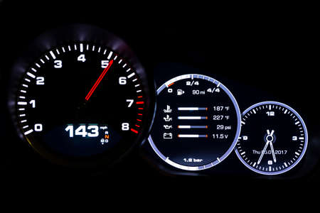 Modern light car mileage (dashboard, milage) isolated on a black background. New display of a modern car. 143 mph. Stock Photo