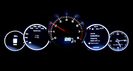Modern light car mileage (dashboard, milage) isolated on a black background. New display of a modern car. 26 mph.