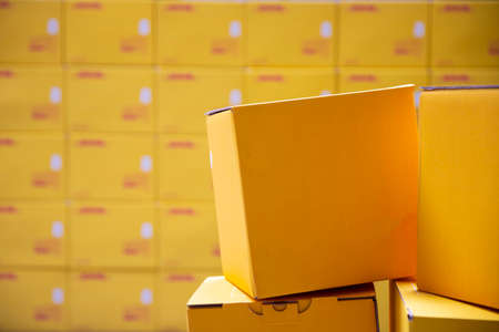 Yellow transportation boxes packages are seen arranged in a warehouse. Фото со стока