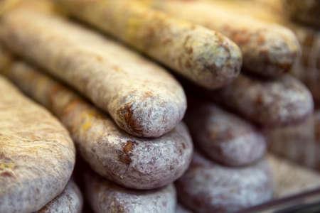Dried salami sausages. Traditional Bulgarian dried flat salami. Stock fotó
