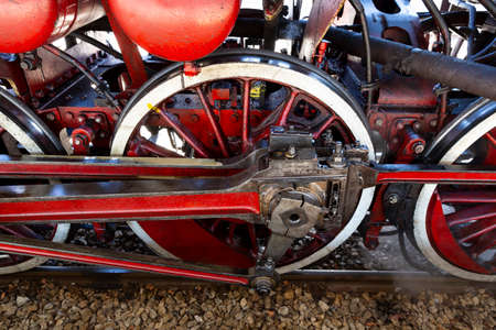 Red wheels of a steam train locomotive are seen on the train station railway before departure. Stock fotó