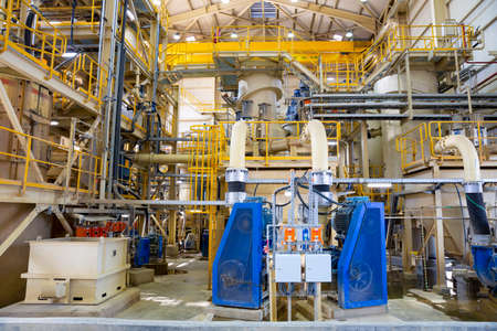 Gold mine processing plant equipment is seen from the inside. 에디토리얼