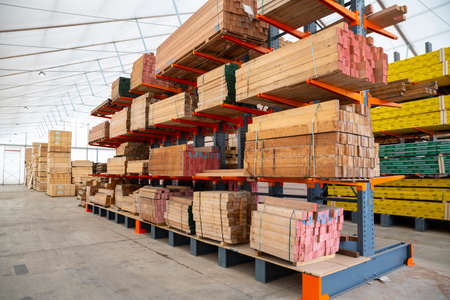 Wooden planks in a factory. Wood and wood-based materials industry.