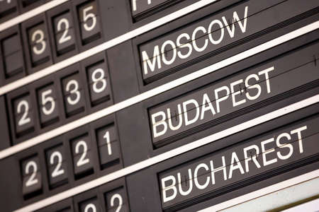 Old flight information display system. Split-flap (or just flap) display. Often used as a public transport timetable in airports or railway stations. Moscow, Budapest, Bucharest. Zdjęcie Seryjne