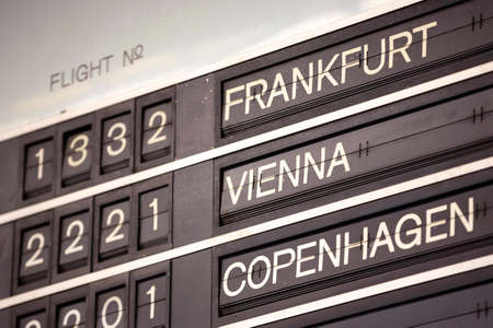 Old flight information display system. Split-flap (or just flap) display. Often used as a public transport timetable in airports or railway stations. Frankfurt, Vienna, Copenhagen.