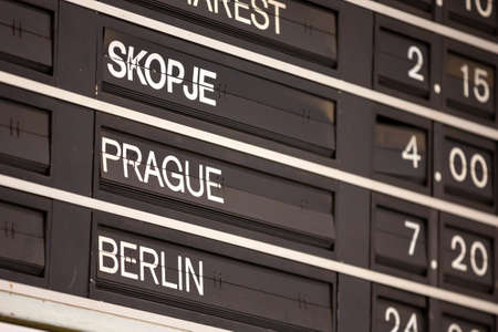 Old flight information display system. Split-flap (or just flap) display. Often used as a public transport timetable in airports or railway stations. Skpje, Prague, Berlin. Foto de archivo