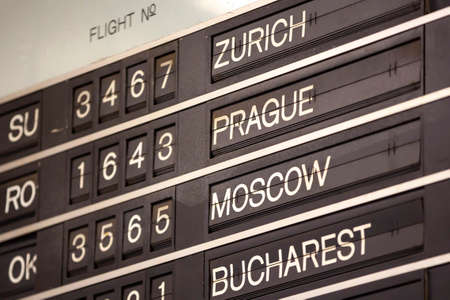 Old flight information display system. Split-flap (or just flap) display. Often used as a public transport timetable in airports or railway stations. Zurich, Prague, Moscow, Bucharest.