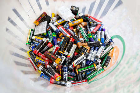 Sofia, Bulgaria - 23 January, 2020: Different batteries are seen thrown away in a recycling bin.