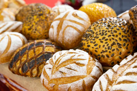 Different kinds of breads seen from above.
