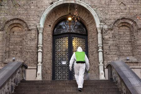 Worker sprays disinfectant outside of Sveta Nedelya Church against the spread of coronavirus disease COVID-19. 免版税图像 - 145540824