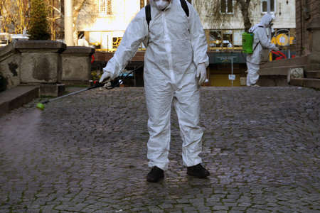 Worker sprays disinfectant outside of Sveta Nedelya Church against the spread of coronavirus disease COVID-19. 新闻类图片