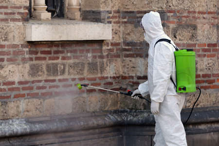 Worker sprays disinfectant outside Sveti Sedmochislenitsi (Seven Saints) church against the spread of coronavirus disease COVID-19. 免版税图像 - 145540829