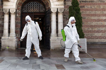 Sofia, Bulgaria - 11 April, 2020: Workers spray disinfectant outside Sveti Sedmochislenitsi (Seven Saints) church against the spread of coronavirus disease COVID-19. 免版税图像 - 146337555