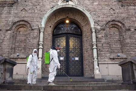 Sofia, Bulgaria - 11 April, 2020: Workers spray disinfectant outside of Sveta Nedelya Church against the spread of coronavirus disease COVID-19. 免版税图像 - 148825679