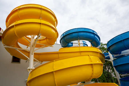 A water slide (flume, water chute) is a type of slide designed for warm-weather or indoor recreational use at water parks. 免版税图像 - 150795944
