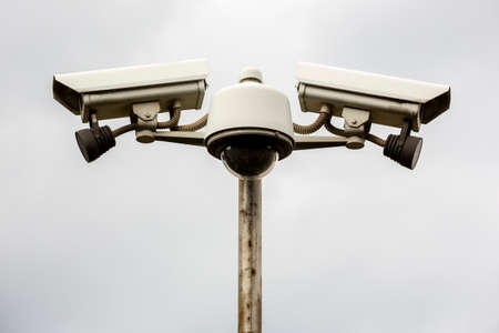 Street cameras for surveillance in front of a building. 免版税图像