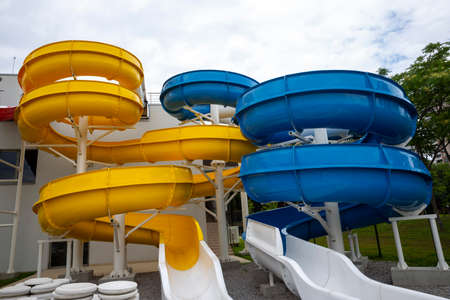 A water slide (flume, water chute) is a type of slide designed for warm-weather or indoor recreational use at water parks. 免版税图像 - 152492791
