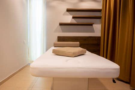 Empty dry massage room in a spa center. 免版税图像