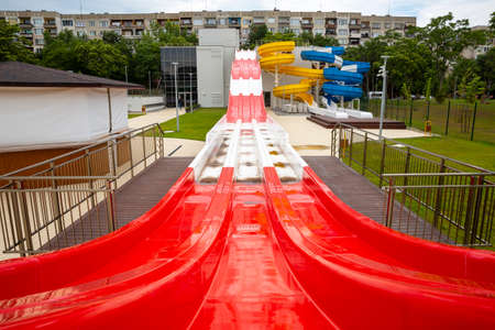 A water slide (flume, water chute) is a type of slide designed for warm-weather or indoor recreational use at water parks. 免版税图像
