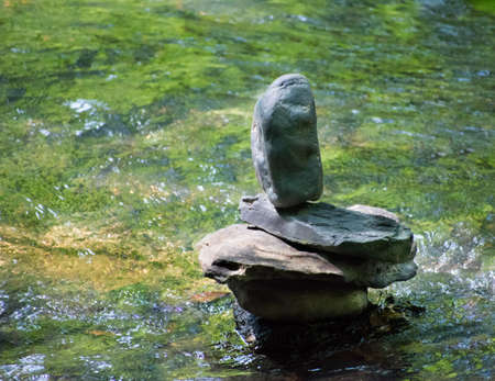 balancing rock in the river
