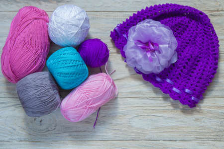colored wool for knitting wit hat. Stock Photo