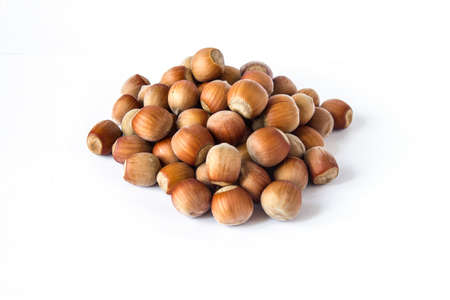 nutshells: Pile of hazelnuts isolated on white background