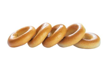 Raw of baked bagels isolated on white background Stock Photo