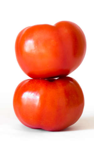Two red tomatoes in a pile isolated on white background, side view Stock Photo