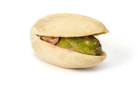 One pistachio nut cloe up isolated on white backgrond, macro Stock Photo