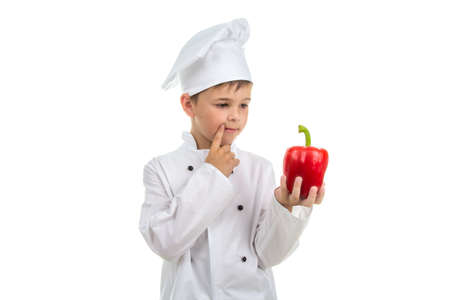 Young chef thinking about creative salad idea to make - isolated on white