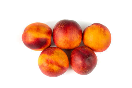 Delicious appetizing nectarines arranged in accurate order