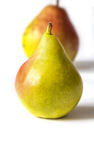A couple pears on white background. Macro view
