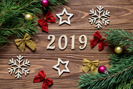 New Year title 2019. Christmas decoration on the wooden background