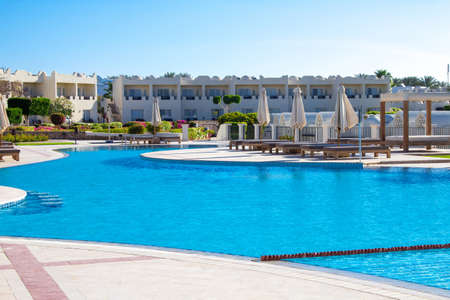 Landscape to the calm deep blue water of the swimming pool in Sharm El Sheikh resort, grand hotel