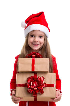 Cheered christmas girl holding two gift boxes in the hands, wearing a santa hat isolated over a white background