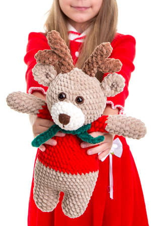 Eco toys, the deer soft toy in the christmas girls hands on the white background