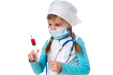 Nurse with medical face mask and a syringe with a red substance, landscape