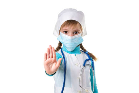 Female nurse doing stop sign with palm wearing medical mask. Warning expression with negative and serious gesture.
