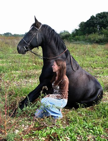 rearing: sitted horse and teenager Stock Photo