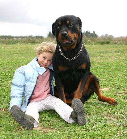 little girl and her rottweiler