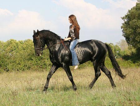pony girl: teen and black horse