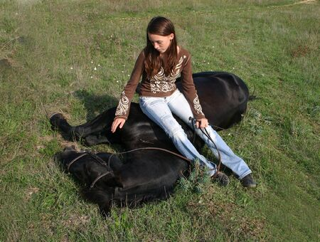 complicit�: complicit� fille et cheval noir